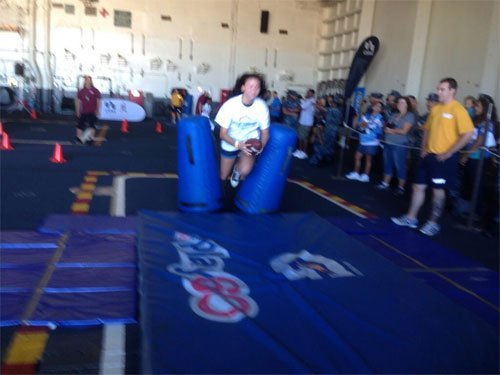 Kids on USS Ronald Reagan having fun being Chargers! Pic from News 8's Steve Price