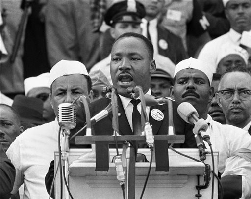 """FILE - In this Aug. 28, 1963 file photo, Dr. Martin Luther King Jr., head of the Southern Christian Leadership Conference, addresses marchers during his """"I Have a Dream"""" speech at the Lincoln Memorial in Washington. (AP Photo/File)"""