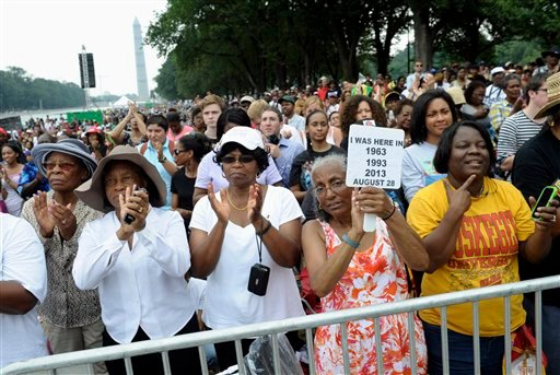 Three women who attended previous March's on Washington, from left, Armanda Hawkins of Memphis, Vera Moore of Washington, and Betty Waller Gray of Richmond, Va., (holding sign) listen to the speakers during the March on Washington, Wednesday, Aug. 28.(AP)