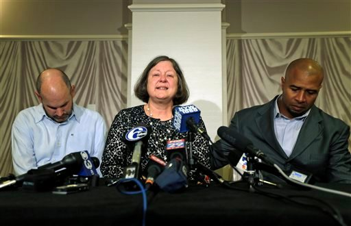 April 9, 2013: Former NFL player Dorsey Levens, right, extends a hand as Mary Ann Easterling, the widow of former NFL player Ray Easterling, reacts as former NFL player Kevin Turner, left, looks on during a news conference. (AP Photo/Matt Rourke, File)