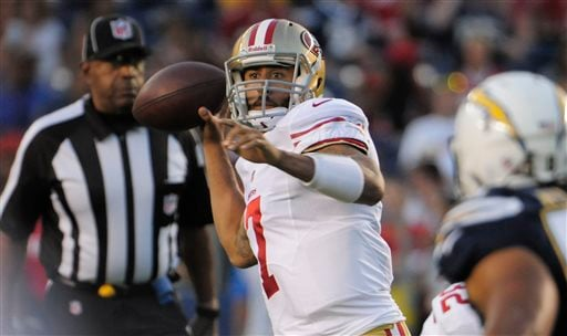 San Francisco 49ers quarterback Colin Kaepernick looks to throw a pass against the San Diego Chargers during the first half of an NFL preseason football game, Thursday, Aug. 29, 2013, in San Diego.