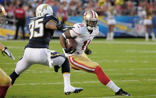 San Francisco 49ers wide receiver Quinton Patton, right, makes his way past San Diego Chargers defensive back Marcus Cromartie, left, on his way to scoring a touchdown.