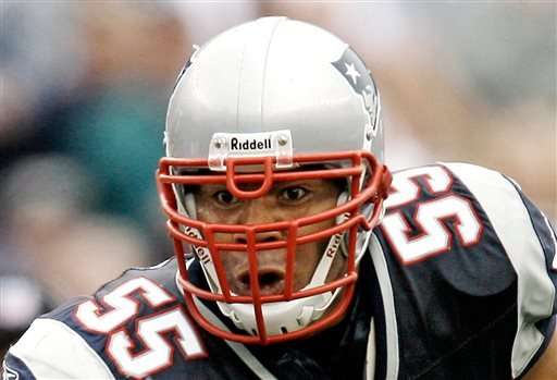 In this Oct. 7, 2007 file photo, New England Patriots linebacker Junior Seau runs with the ball after an interception during New England's 34-17 win over the Cleveland Browns in a football game at Gillette Stadium in Foxborough, Mass.
