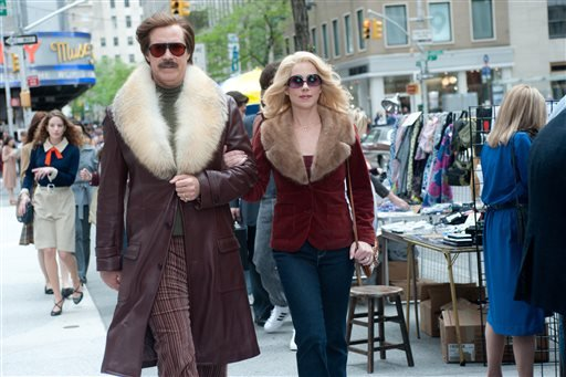 "This film publicity image released by Paramount Pictures shows Will Ferrell as Ron Burgundy, left, and Christina Applegate as Veronica Corningstone in a scene from ""Anchorman 2: The Legend Continues."" (AP Photo/Paramount Pictures, Gemma LaMana)"