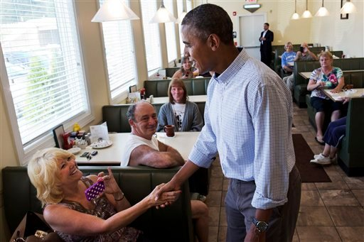 In this Aug. 23, 2013, file photo, President Barack Obama greets patrons at Bingham's Family Restaurant, where he stopped to buy pie, in Lenox, Pa.