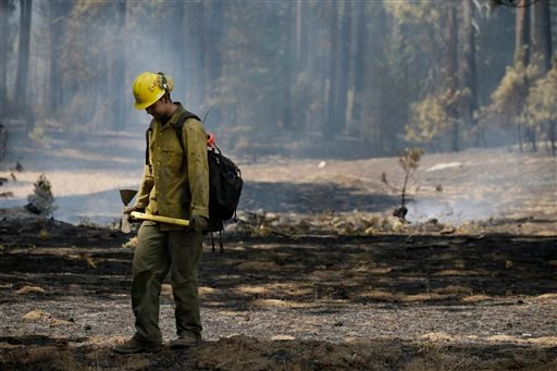 Firefighter Troy Drouin takes a short break before mopping up hot spots near Yosemite National Park, Calif., on Wednesday, Aug. 28, 2013. (AP)
