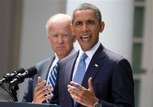 President Barack Obama stands with Vice President Joe Biden as he makes a statement about Syria in the Rose Garden at the White House in Washington, Saturday, Aug. 31, 2013.
