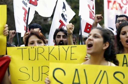 Turkish Workers party supporters shout slogans during a demonstration in Hatay, Turkey, Saturday, Aug. 31, 2013.