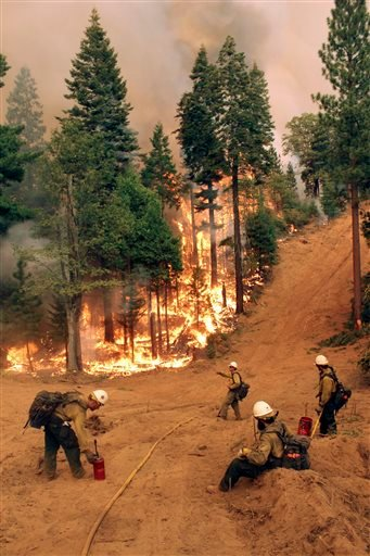 In this photo provided by the U.S. Forest Service, members of the BLM Silver State Hotshot crew perform burn operations on the southern flank of the Rim Fire near Yosemite National Park in California Friday, Aug. 30, 2013.