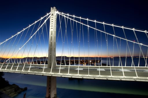 In a handout photo provided by the Bay Area Toll Authority, LED lights illuminate the San Francisco-Oakland Bay Bridge's self-anchored suspension on Thursday, Aug. 29, 2013, in San Francisco.