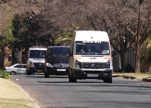 An ambulance transporting former South African president Nelson Mandela arrives at the home of the former statesman in Johannesburg, South Africa, Sunday, Sept. 1, 2013.