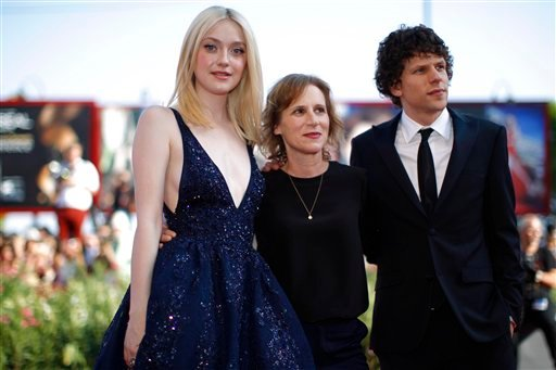 Actress Dakota Fanning, director Kelly Reichardt and actor Jesse Eisenberg pose for photographers on the red carpet for the screening of the film Night Moves at the 70th edition of the Venice Film Festival held from Aug. 28 through Sept. 7, in Venice.