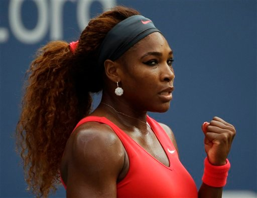 Serena Williams pumps her fists after a point against Sloane Stephens during the fourth round of the 2013 U.S. Open tennis tournament, Sunday, Sept. 1, 2013, in New York. (AP Photo/David Goldman)