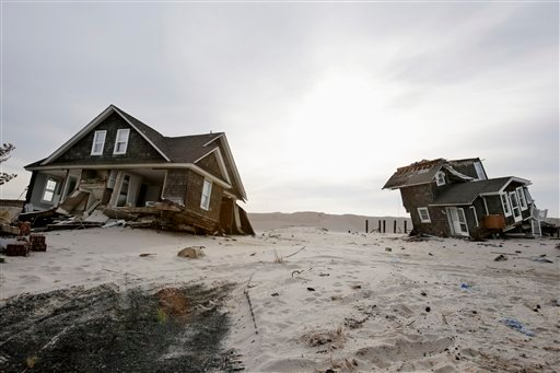 This Feb. 22,2013 file photo shows Two heavily damaged homes on the beach in Mantoloking, N.J., from Superstorm Sandy.