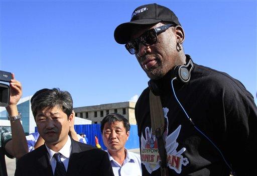 Former NBA star Dennis Rodman arrives at Pyongyang airport, North Korea, Tuesday, Sept. 3, 2013.
