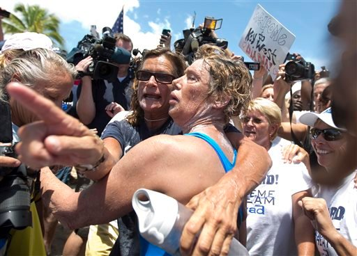 Endurance swimmer Diana Nyad, right, and her trainer, Bonnie Stoll hug after Nyad walks ashore Monday, Sept. 2, 2013 in Key West, Fla.