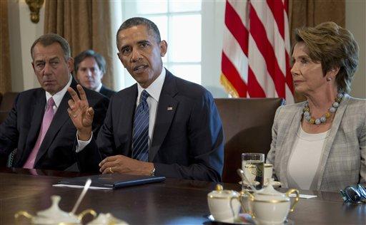 President Barack Obama, flanked by House Speaker John Boehner of Ohio, left, and House Minority Leader Nancy Pelosi of Calif., speaks to media in the Cabinet Room of the White House in Washington, Tuesday, Sept. 3, 2013. (AP Photo/Carolyn Kaster)