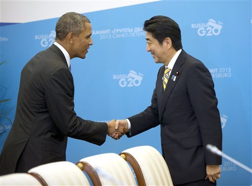 US President Barack Obama, left, and Japan's Prime Minister Shinzo Abe, right, shake hands before the start of their bilateral meeting at the G20 Summit, Thursday, Sept. 5, 2013 in St. Petersburg, Russia. (AP Photo/Pablo Martinez Monsivais)