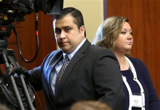 FILE - In this Monday, June 24, 2013 file photo, George Zimmerman, left, arrives in Seminole circuit court with his wife, Shellie, on the 11th day of his trial, in Sanford, Fla. (AP)