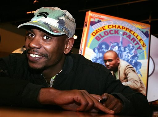 "FILE - In this June 13, 2006 file photo, comedian Dave Chappelle promotes the release of his new DVD ""Dave Chappelle's Block Party,"" at the Virgin Megastore in Los Angeles. (AP)"
