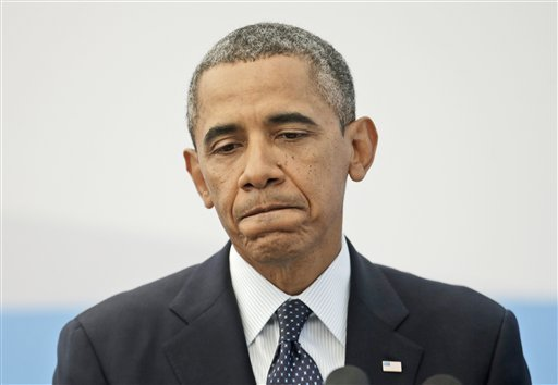 US President Barack Obama pauses as he answers a question regarding the ongoing situation in Syria during his news conference at the G-20 Summit in St. Petersburg, Russia, Friday, Sept. 6, 2013.