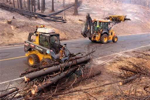 In this photo provided by the U.S. Forest Service, Crews clear California Highway 120 of debris, as crews continue to fight the Rim Fire near Yosemite National Park in California Wednesday, Sept. 4, 2013.