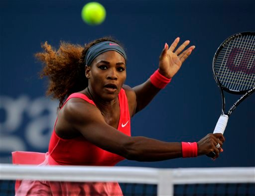 Serena Williams returns a shot to Li Na, of China, during the semifinals of the 2013 U.S. Open tennis tournament, Friday, Sept. 6, 2013, in New York. (AP Photo/Charles Krupa)