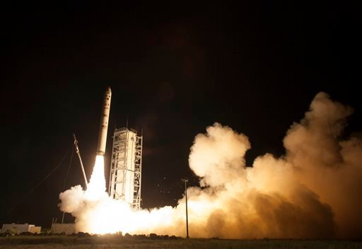 In this photo provided by NASA, an unmanned Minotaur rocket carries NASA's newest robotic explorer, the LADEE spacecraft, which is charged with studying the lunar atmosphere and dust, after launching to the moon from NASA's Wallops Flight Facility.