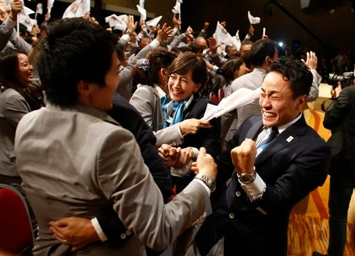 Members of the Tokyo 2020 delegation celebrate after Tokyo was awarded the 2020 Olympic Games during the 125th IOC session in Buenos Aires, Argentina, Saturday, Sept. 7, 2013. (AP Photo/Victor R. Caivano)
