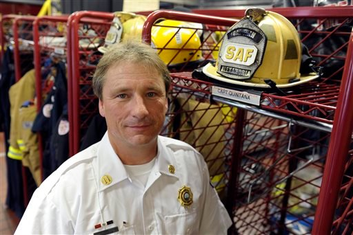 Alexandria, Va., firefighter Capt. Scott Quintana, who has chronic Myeloid leukemia that was diagnosed in 2010, poses for a photo at his fire station in Alexandria, Thursday, Sept. 5, 2013. (AP Photo/Susan Walsh)