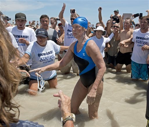 In this Monday, Sept. 2, 2013 file photo provided by the Florida Keys News Bureau, Diana Nyad emerges from the Atlantic Ocean after completing a 111-mile swim from Cuba to Key West, Fla. (AP Photo/Florida Keys Bureau, Andy Newman, File)