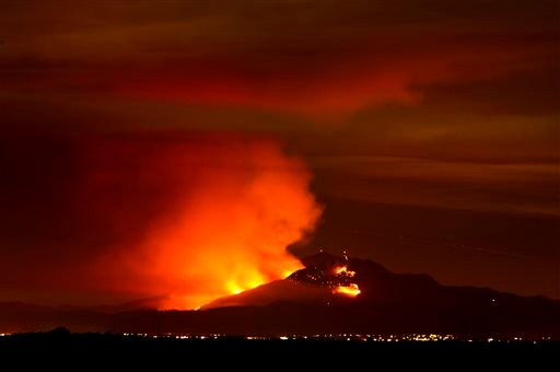 A wildfire burns out of control on the slopes of Mount Diablo in Contra Costa County, Calif., seen from the Woodbridge Ecological Reserve located in the Sacramento–San Joaquin River Delta, Sunday, Sept. 8, 2013.