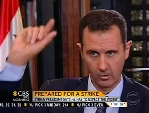 "In this frame grab from video taken Sunday, Sept. 8, 2013, and provided by ""CBS This Morning,"" Syrian President Bashar Assad responds to a question from journalist Charlie Rose during an interview in Damascus, Syria."