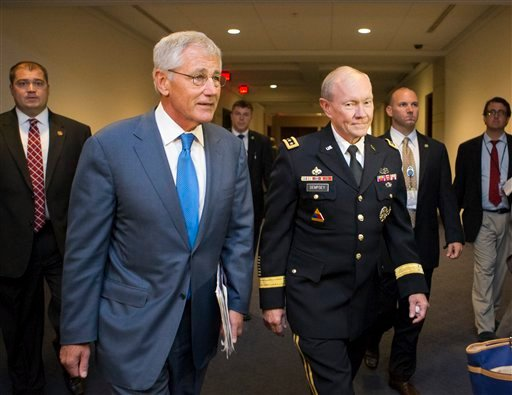 Defense Secretary Chuck Hagel, left, and Joint Chiefs Chairman Gen. Martin Dempsey arrive for a closed-door intelligence briefing with members of the House of Representatives on the situation in Syria, Sept. 9, 2013. (AP Photo/J. Scott Applewhite)
