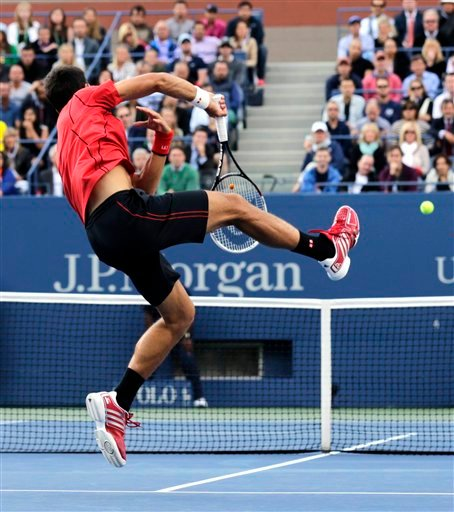 Novak Djokovic, of Serbia, returns a shot at the net to Rafael Nadal, of Spain, during the men's singles final of the 2013 U.S. Open tennis tournament, Monday, Sept. 9, 2013, in New York. (AP Photo/Charles Krupa)