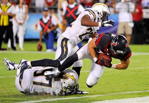 Houston Texans tight end Garrett Graham, right, scores between San Diego Chargers linebacker Bront Bird, left, and running back Ronnie Brown during the second half of an NFL football game.