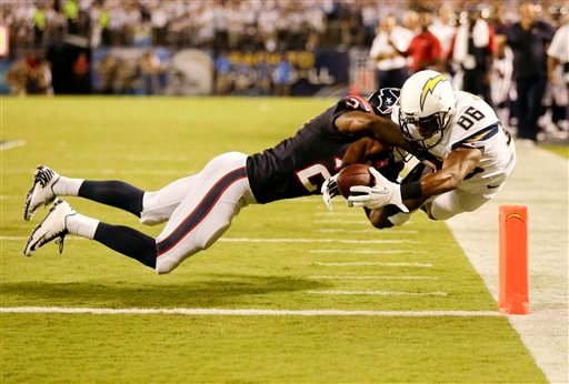 San Diego Chargers wide receiver Vincent Brown, right, scores past Houston Texans cornerback Johnathan Joseph.