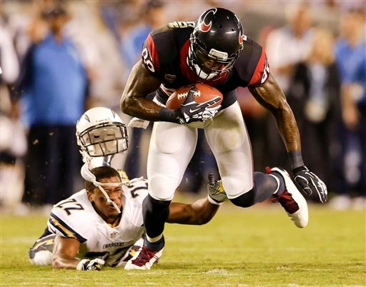 Houston Texans wide receiver Andre Johnson, right, breaks away from San Diego Chargers cornerback Derek Cox.