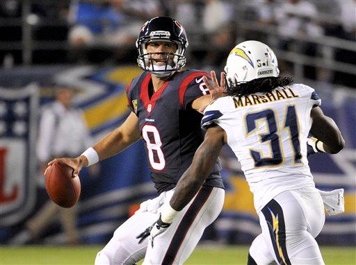 Houston Texans quarterback Matt Schaub throws under pressure by San Diego Chargers defensive back Richard Marshall.