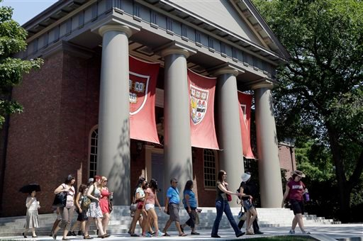 In this Aug. 30, 2012, file photo, people are led on a tour on the campus of Harvard University in Cambridge, Mass.