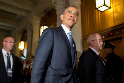 President Barack Obama, accompanied by Senate Sergeant at Arms and Doorkeeper Terrance Gainer, right, leaves a meeting with congressional Republicans on Capitol Hill in Washington, Tuesday, Sept. 10, 2013, where they discussed Syria. (AP)