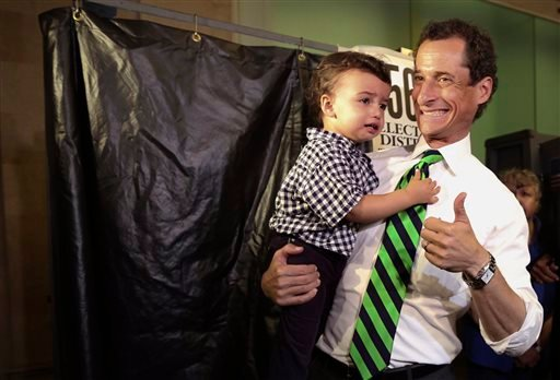 Democratic mayoral hopeful Anthony Weiner holds his son Jordan as he leaves the voting booth after casting his vote at his polling station during the primary election in New York, Tuesday, Sept. 10, 2013. (AP Photo/Mary Altaffer)
