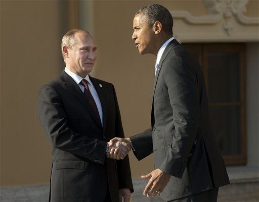 FILE - In this Sept. 5, 2013 pool-file photo, President Barack Obama shakes hands with Russia's President Vladimir Putin during arrivals for the G-20 summit at the Konstantin Palace in St. Petersburg, Russia. (AP)
