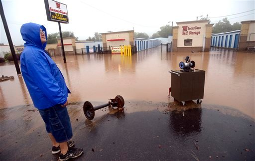 David Platco looks over a flooded and damage storage facility in North Boulder, Colo., on Thursday, Sept. 12, 2013.