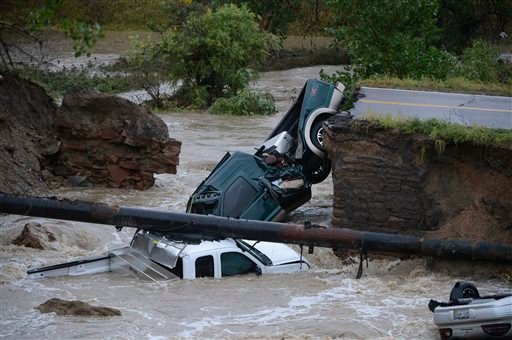 Three vehicles crashed into a creek after the road washed out from beneath them near Dillon Rd. and 287 in Broomfield Colo., Thursday, Sept. 12, 2013 in heavy flooding.