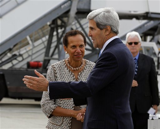 U.S. Secretary of State John Kerry, foreground, is welcomed by the U.S. Permanent Representative to the United Nations in Geneva Amb. (AP Photo/Larry Downing, Pool)