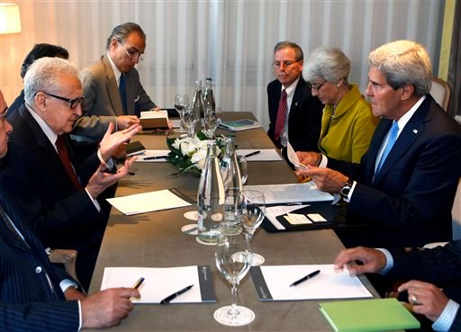 U.S. Secretary of State John Kerry, right, talks with the U.N. Special Representative for Syria Lakhdar Brahimi, second left, in Geneva, Switzerland on Thursday, Sept. 12, 2013. (AP)