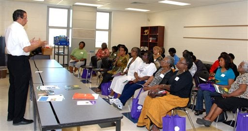 Wallace Cunningham, left, AARP South Carolina Associate State Director for Multicultural Outreach presenting a workshop on the Affordable Health Care Act on Sept. 7, 2013 in Bishopville, S.C. (AP Photo/AARP)