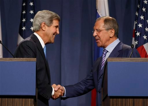 U.S. Secretary of State John Kerry shakes hands with Russian Foreign Minister Sergey Lavrov, right, during a press conference. (AP Photo/Larry Downing, Pool)