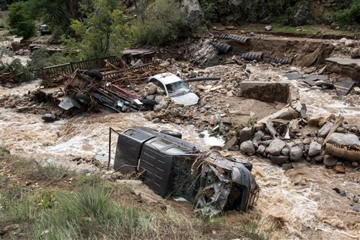 This Sept. 13, 2013 photo provided by Earth Vision Trust shows destruction on Gold Run Creek north of Boulder, Colo., on Sept. 13, 2013.